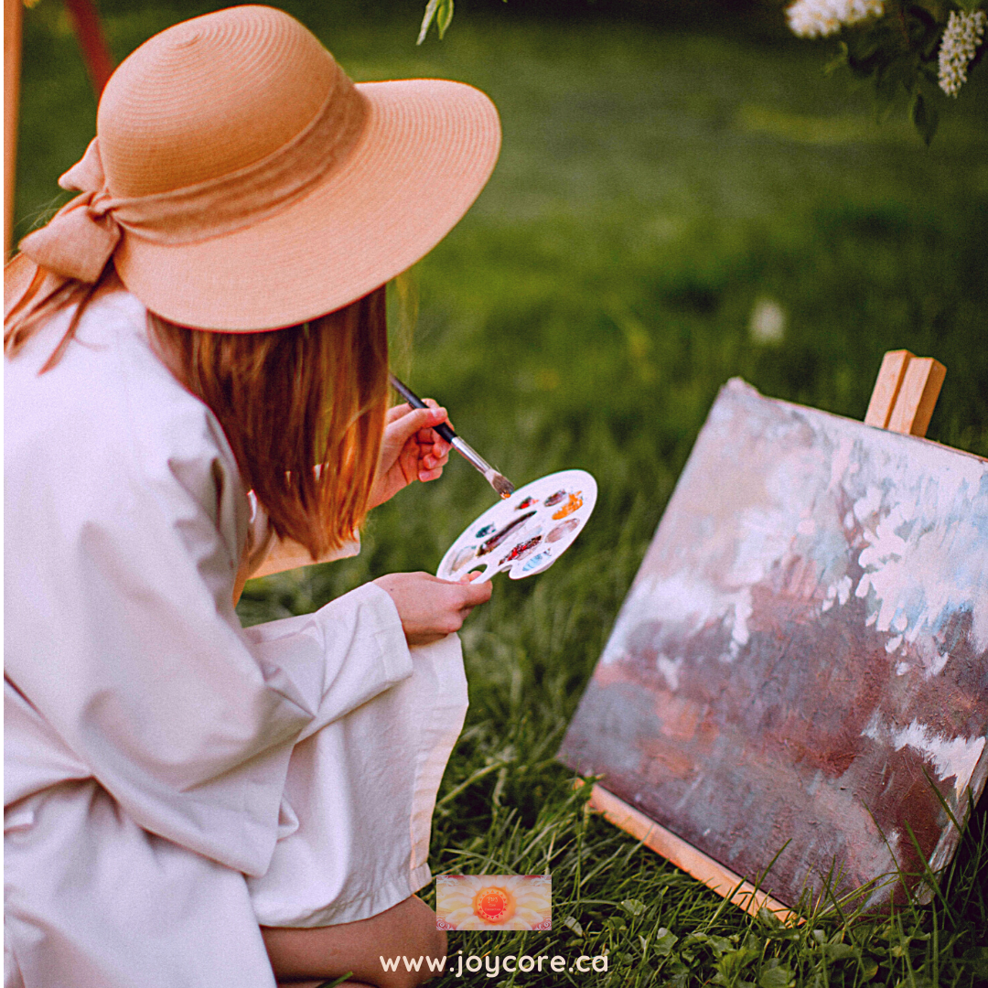 Girl creatively paint on the grass