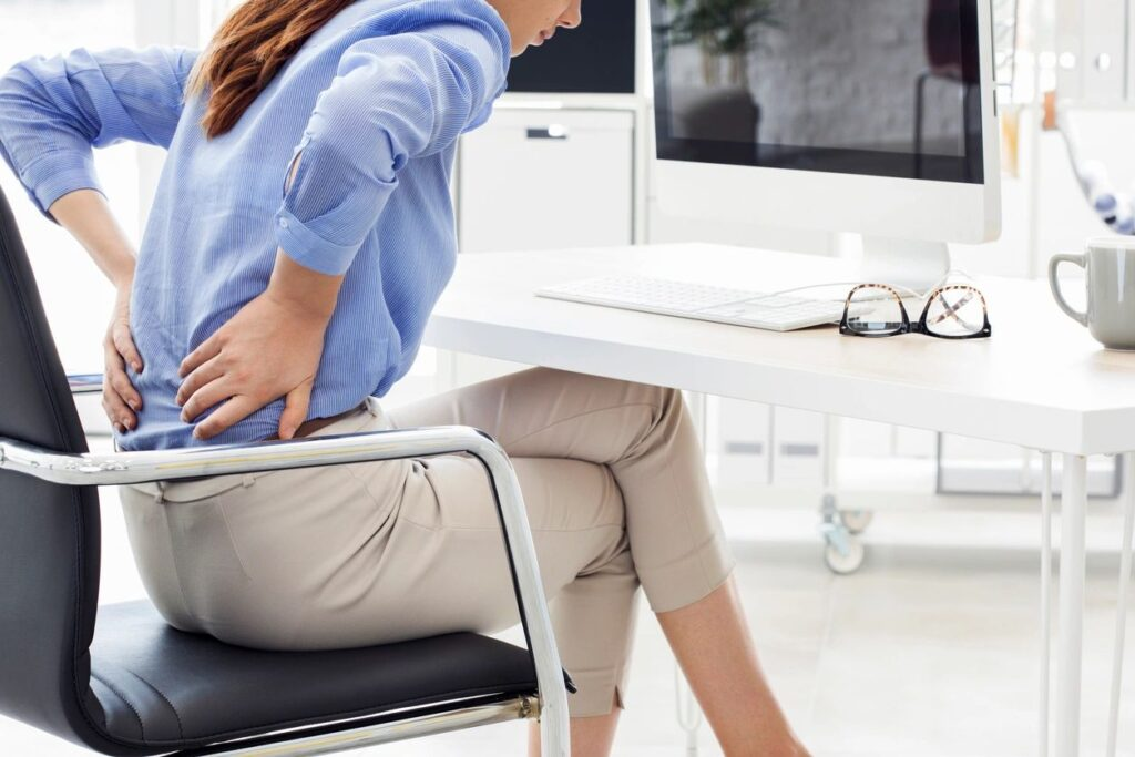 Woman with lower back pain resist self-care.